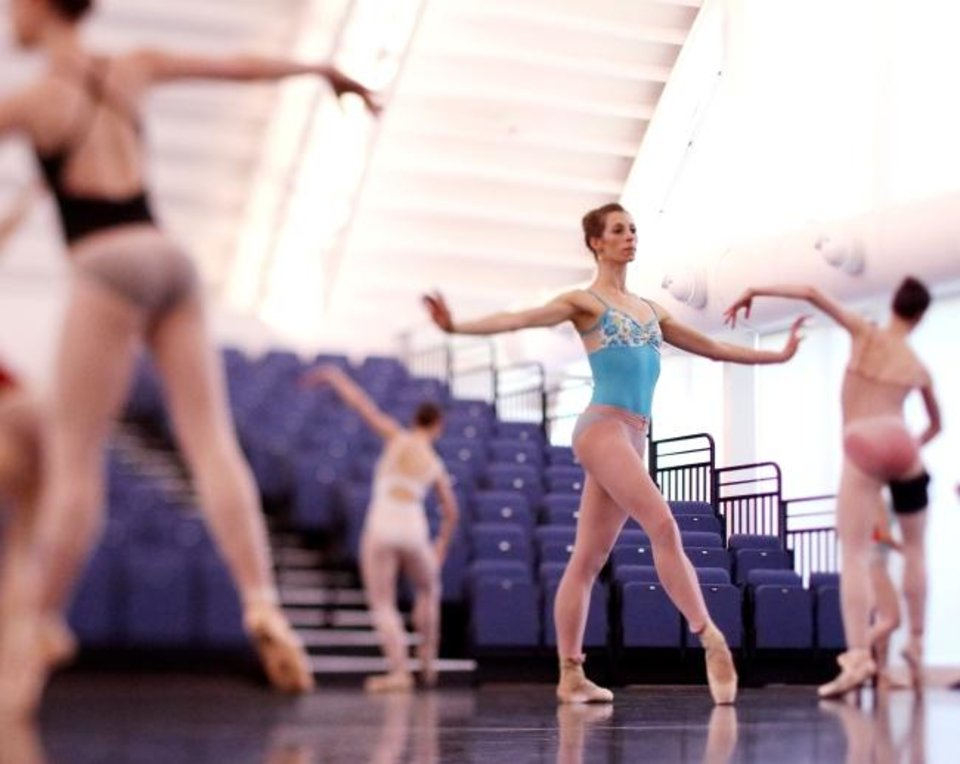Photo -  Oklahoma City Ballet Principal Dancer Courtney Connor Jones, center, rehearses April 8 at the Susan E. Brackett Dance Center. [Doug Hoke/The Oklahoman]