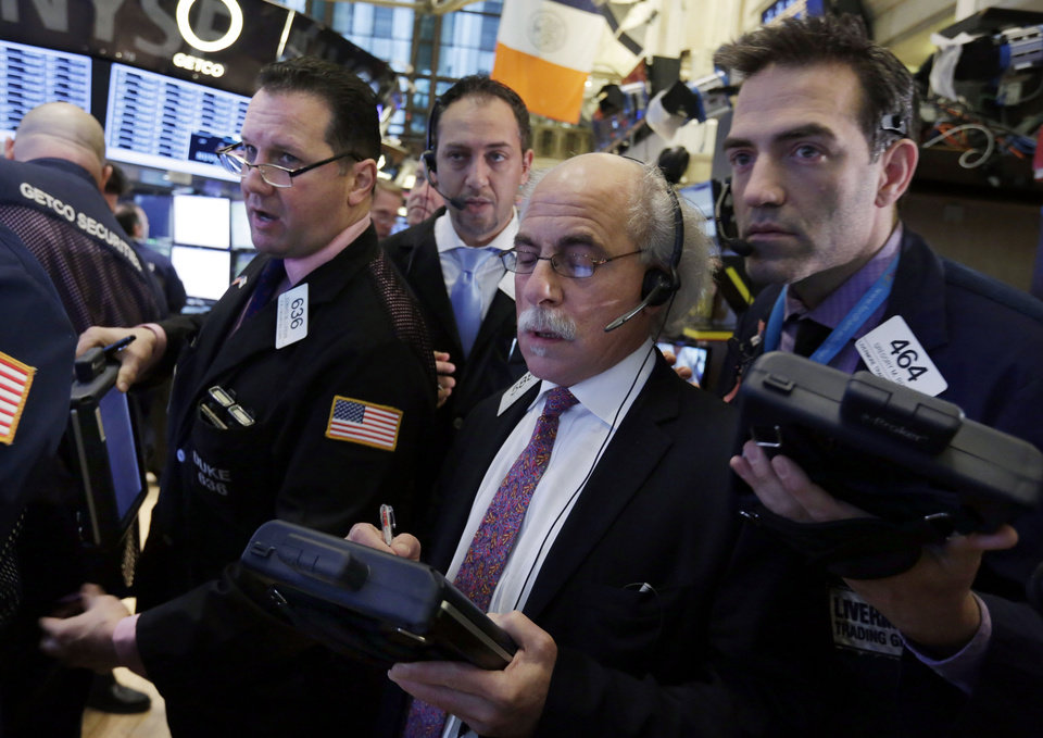 Photo - Traders gather at a post on the floor of the New York Stock Exchange Thursday, Jan. 10, 2013. Stocks opened higher on Wall Street Thursday, gaining for a second day, after the European Central Bank chief said the region was poised to start growing again, bolstering expectations that the worst of the region's crisis is behind it. (AP Photo/Richard Drew)