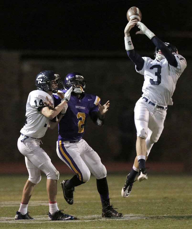 Photo - El Reno's Cal Baker (3) intercepts a pass intended for NWC's Fre'Darian Ashley (2) during a high school football game between Northwest Classen and El Reno at Taft Stadium in Oklahoma City, Friday, Oct. 5, 2012.  Photo by Garett Fisbeck, The Oklahoman