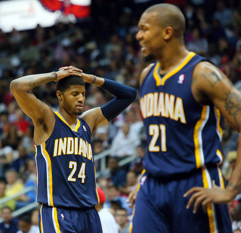 Photo - Indian Pacers Paul George, left, and David West react in the second half as the Atlanta  Hawks defeat the Pacers 102-91  in Game 4 of their first-round NBA basketball playoff series game Monday, April 29, 2013, in Atlanta. The win ties the first round series 2-2.   (AP Photo/ Journal-Constitution, Curtis Compton)
