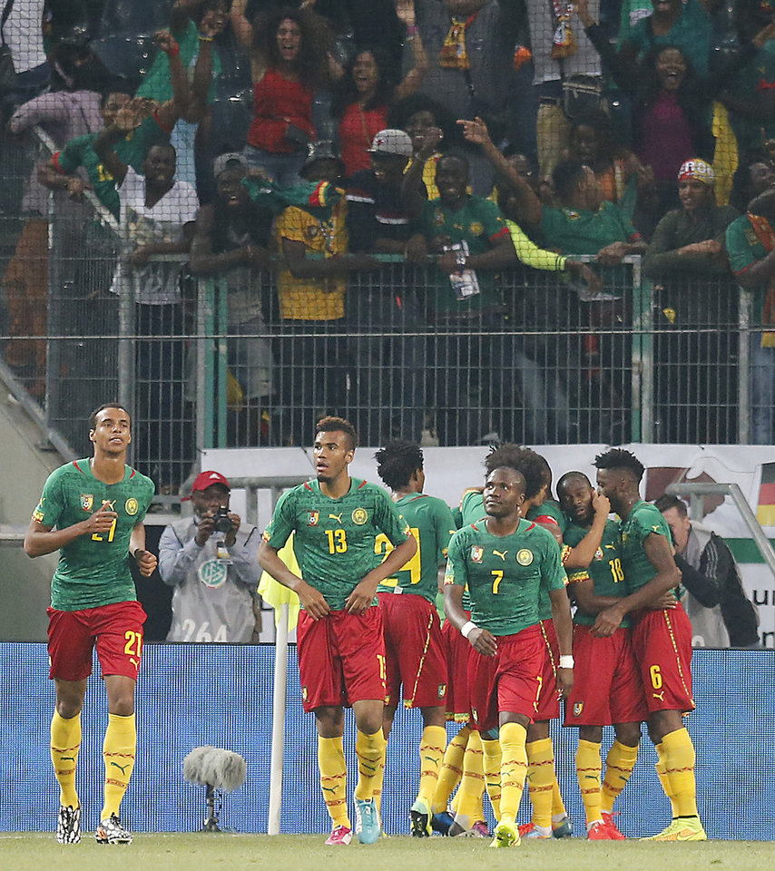 Photo - Cameroon's teammates celebrate scoring during a friendly WCup preparation soccer match between Germany and Cameroon in Moenchengladbach, Germany, Sunday, June 1, 2014. (AP Photo/Frank Augstein)