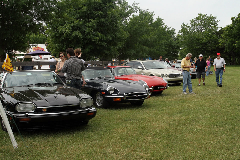 Photo - A variety of Jaguar cars were on display during the Iron Thistle Festival in Yukon, Saturday, April 28th, 2012. PHOTO BY HUGH SCOTT, FOR THE OKLAHOMAN   ORG XMIT: KOD