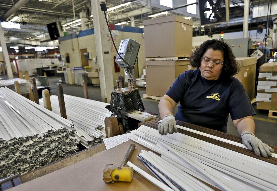Elsa Caldcrow works on production of products at the MD Building Products plant on Wednesday, Jan. 2, 2013, in Oklahoma City, Okla. Photo by Chris Landsberger, The Oklahoman