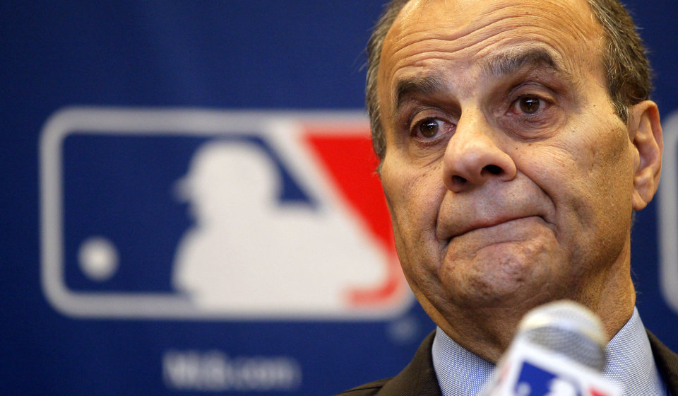 Photo -   Joe Torre, executive vice president for baseball operations for Major League Baseball, listens to reporters question about instant replay during a news conference after meeting with baseball owners, Thursday, Nov. 15, 2012, in Chicago. (AP Photo/Charles Rex Arbogast)