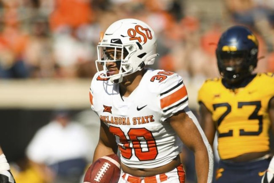 Photo -  Oklahoma State running back Chuba Hubbard (30) has averaged 4.0 yards per carry through the first two games of the season. [AP Photo/Brody Schmidt]
