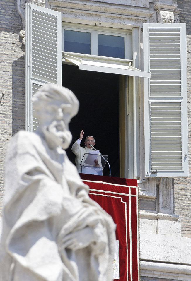 Photo - Pope Francis delivers the Angelus prayer from his studio's window, overlooking St. Peter's Square at the Vatican, Sunday, June 30, 2013.  The Pontiff says his predecessor, Benedict XVI, was courageously following his conscience when he decided to retire. Benedict became the first pontiff in 600 years to quit the post when he resigned in February, paving the way for Francis' election as Pope two weeks later. Francis told pilgrims and tourists in St. Peter's Square on Sunday that God made Benedict understand through prayer the step he had to take.(AP Photo/Gregorio Borgia)