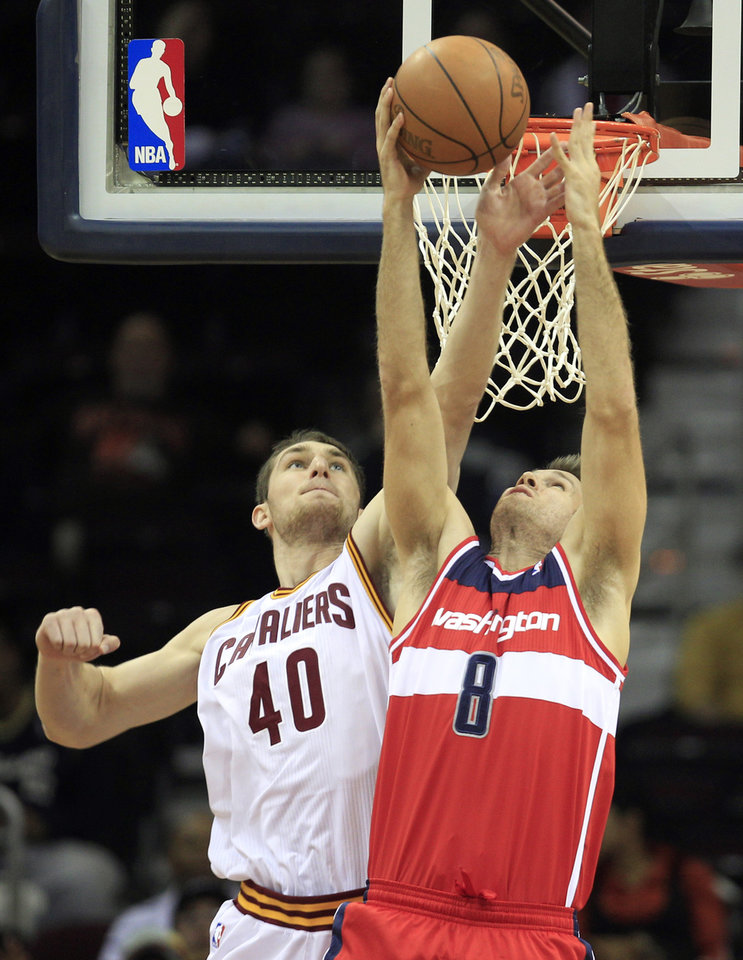 Cleveland Cavaliers' Tyler Zeller (40) blocks a shot by Washington Wizards' Shavlik Randolph (8) during the second quarter of an NBA preseason basketball game Saturday, Oct. 13, 2012, in Cleveland. (AP Photo/Tony Dejak)