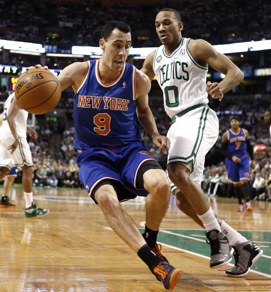 Photo - New York Knicks point guard Pablo Prigioni (9) looks to get around Boston Celtics' Avery Bradley during the second quarter of Game 3 of a first-round NBA basketball playoff series in Boston, Friday, April 26, 2013. (AP Photo/Winslow Townson)