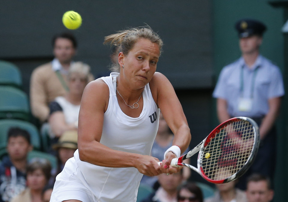 Photo - Barbora Zahlavova Strycova of Czech Republic plays a return to Petra Kvitova of Czech Republic during their women's singles quarterfinal match at the All England Lawn Tennis Championships in Wimbledon, London, Tuesday, July 1, 2014. (AP Photo/Ben Curtis)