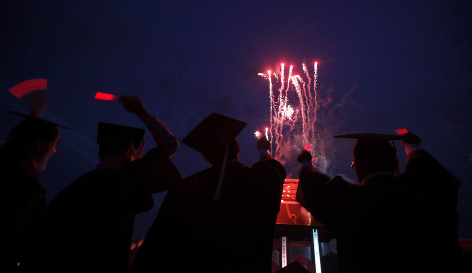 Photo - Graduates watch fireworks following the 2009 University of Oklahoma Commencement at the Gaylord Family -Oklahoma Memorial Stadium, Friday, May 15, 2009, in Norman, Okla. Photo by Sarah Phipps, The Oklahoman