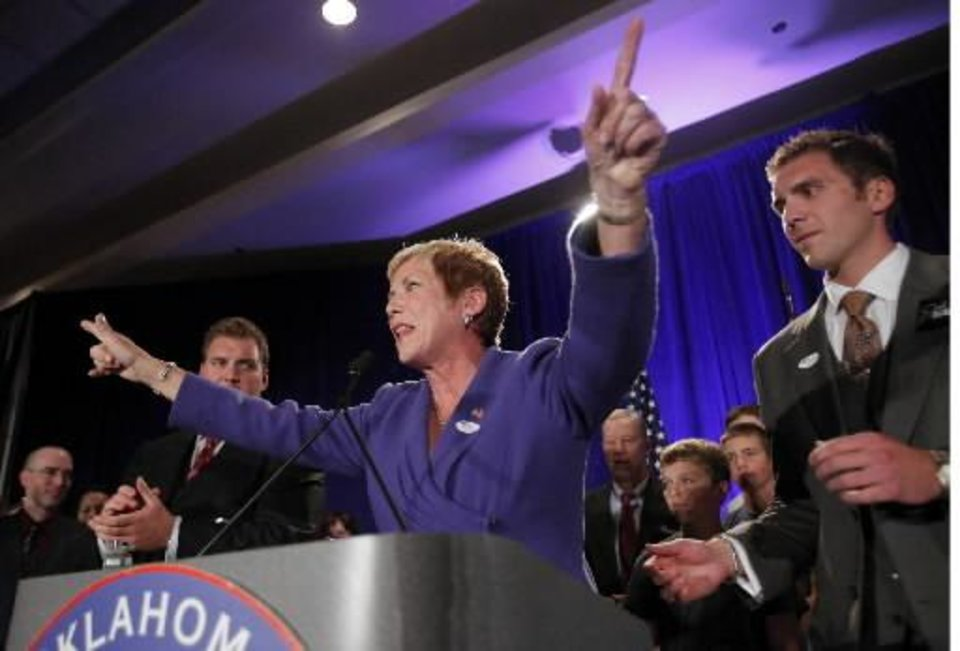 Janet  Barresi  celebrates her superintendent of public schools election with sons Joe, left, and Ben at the republican Watch Party at the Marriott on Tuesday, Nov. 2, 2010, in Oklahoma City, Okla. Photo by Chris Landsberger