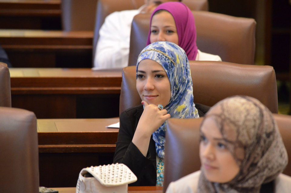 Photo - Muslim Youth Leadership Symposium participants, from front to back,  Maryum Elyazgi of Norman, Layan Salous of Oklahoma City and Kaitlyn Naily of Tulsa, listen during a mock legislative debate at the state Capitol. Photo provided