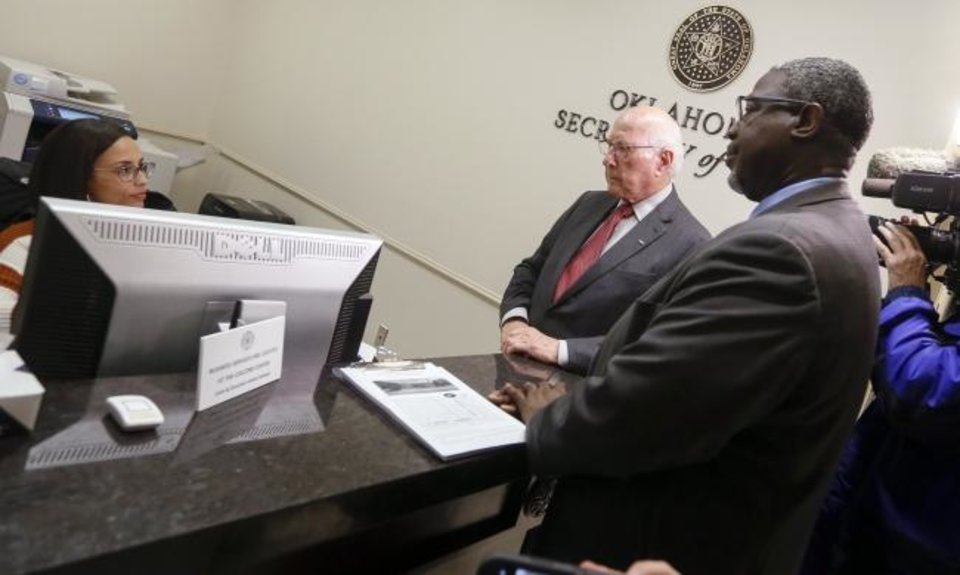 Photo -  Rev. Theodis R. Manning Sr., right, and Gene Rainbolt with Oklahomans for Sentencing Reform file a constitutional ballot initiative Tuesday in the Oklahoma Secretary of State's office at the state Capitol. The initiative would end some sentence enhancements for nonviolent offenses and allow people who are currently serving those sentences to petition for relief. [Nate Billings/The Oklahoman]
