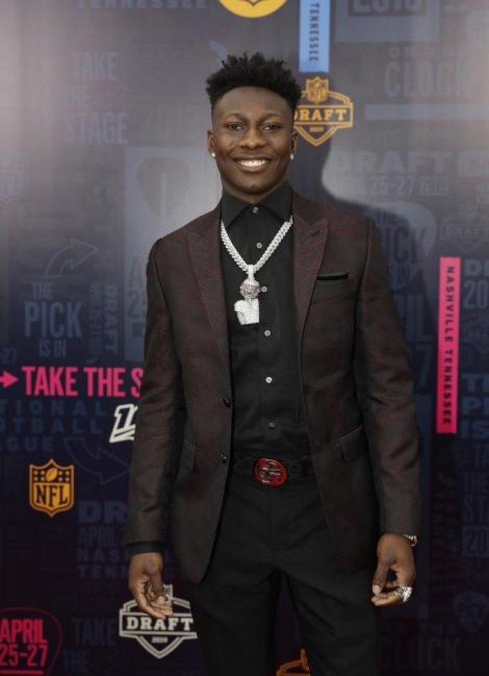 Photo -  Oklahoma wide receiver Marquise Brown walks the red carpet ahead of the first round at the NFL football draft on Thursday night. Brown was selected with the 25th overall pick by the Baltimore Ravens. [AP Photo/Mark Humphrey]