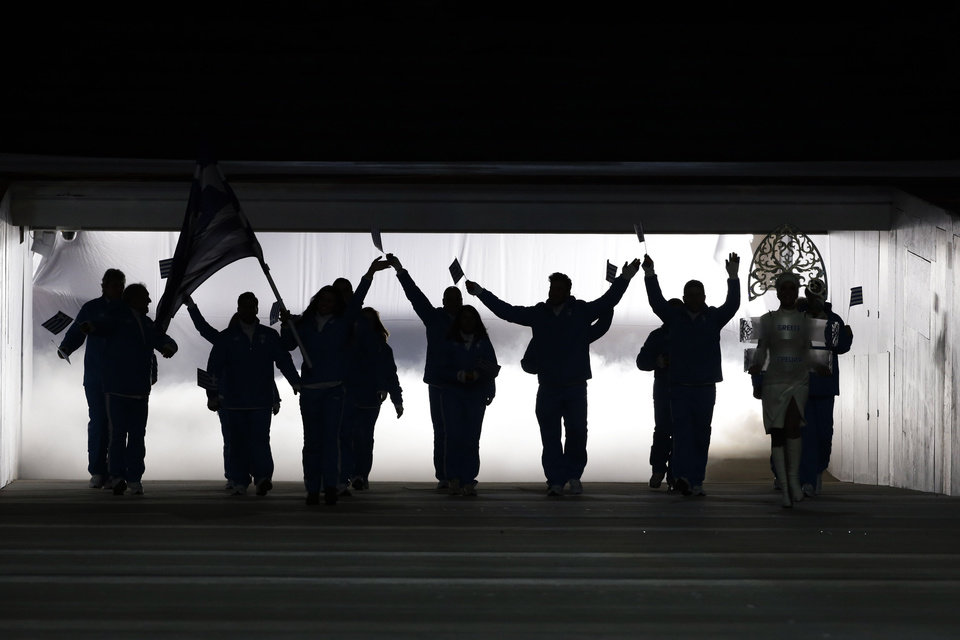 Photo - Athletes from Greece are silhouetted as they arrive during the opening ceremony of the 2014 Winter Olympics in Sochi, Russia, Friday, Feb. 7, 2014. (AP Photo/Mark Humphrey)