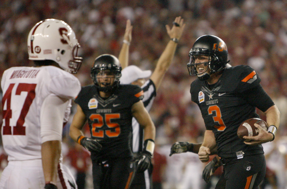 Photo - Oklahoma State's Brandon Weeden (3) celebrates a touchdown in front of Stanford's Myles Muagututia (47) during the Fiesta Bowl between the Oklahoma State University Cowboys (OSU) and the Stanford Cardinal at the University of Phoenix Stadium in Glendale, Ariz., Monday, Jan. 2, 2012. Photo by Sarah Phipps, The Oklahoman