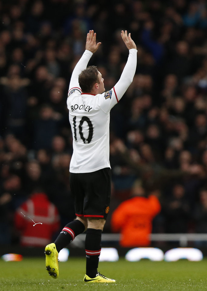 Photo - Manchester United's Wayne Rooney celebrates his goal against West Ham United during their English Premier League soccer match at Upton Park, London, Saturday, March 22, 2014. (AP Photo/Sang Tan)