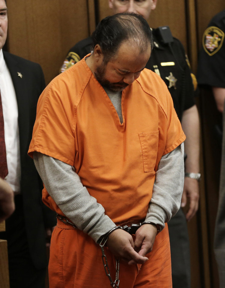 Photo - Ariel Castro walks into the courtroom for his arraignment Wednesday, June 12, 2013, in Cleveland. Castro, accused of holding three women captive in his Cleveland home for about a decade, pleaded not guilty Wednesday to hundreds of charges, including rape and kidnapping. He is charged with kidnapping three women and keeping them _ sometimes restrained in chains _ along with a 6-year-old girl he fathered with one of them.  (AP Photo/Tony Dejak)