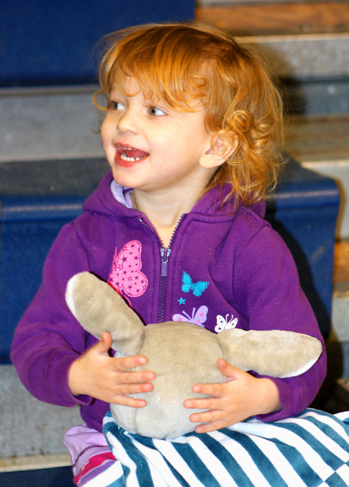Photo - Esme Drucquer, 3, hugs her stuffed rabbit at a candy cane hunt at Irving Recreation Center in Norman. PHOTO BY LYNETTE LOBBAN, FOR THE OKLAHOMAN