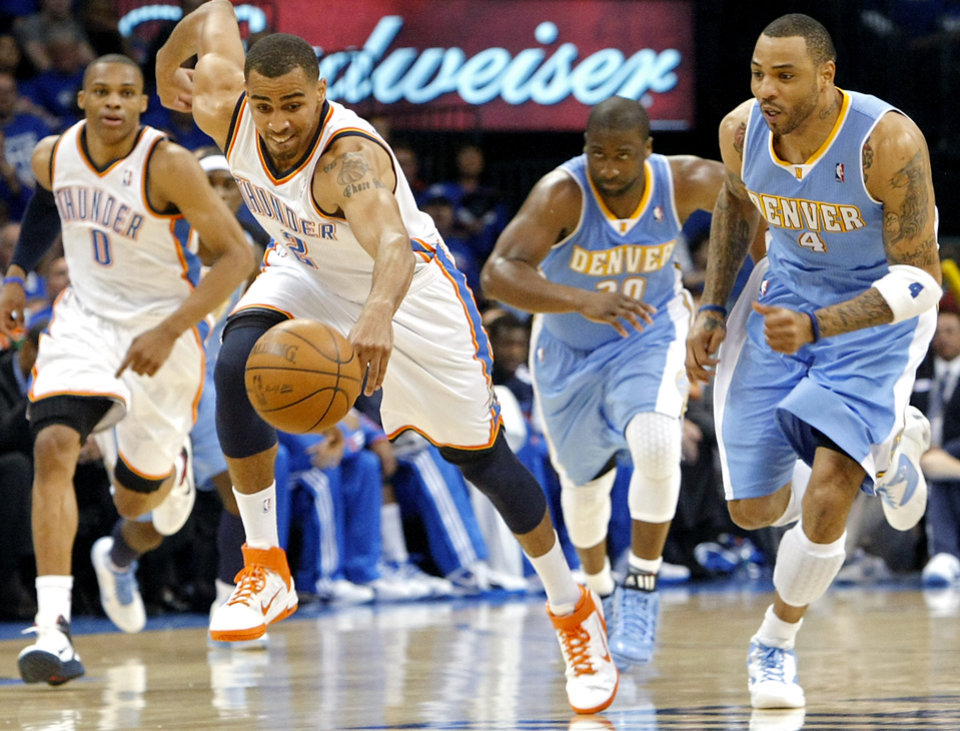 Photo - Oklahoma City's Thabo Sefolosha gets a loose ball and takes in down the court while Russell Westbrook and Denver's Raymond Felton and Kenyon Martin follow during the first round NBA Playoff basketball game between the Thunder and the Nuggets at OKC Arena in downtown Oklahoma City on Wednesday, April 20, 2011. The Thunder beat the Nuggets 106-89 and lead the series 2-0. Photo by John Clanton, The Oklahoman