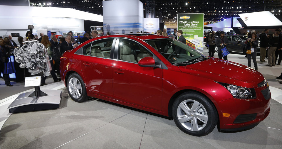 Photo - The 2014 Chevrolet Cruze Diesel is unveiled at the Chicago Auto Show Thursday, Feb. 7, 2013, in Chicago. (AP Photo/Charles Rex Arbogast)
