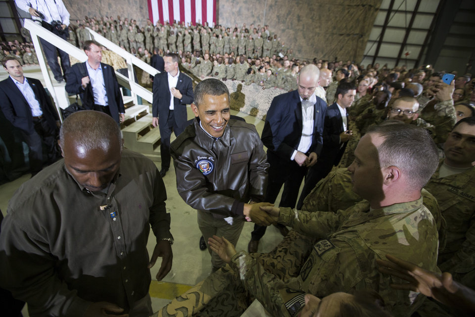 Photo - President Barack Obama shakes hands at a troop rally at Bagram Air Field, north of Kabul, Afghanistan, during an unannounced visit, on Sunday, May 25, 2014. (AP Photo/ Evan Vucci)