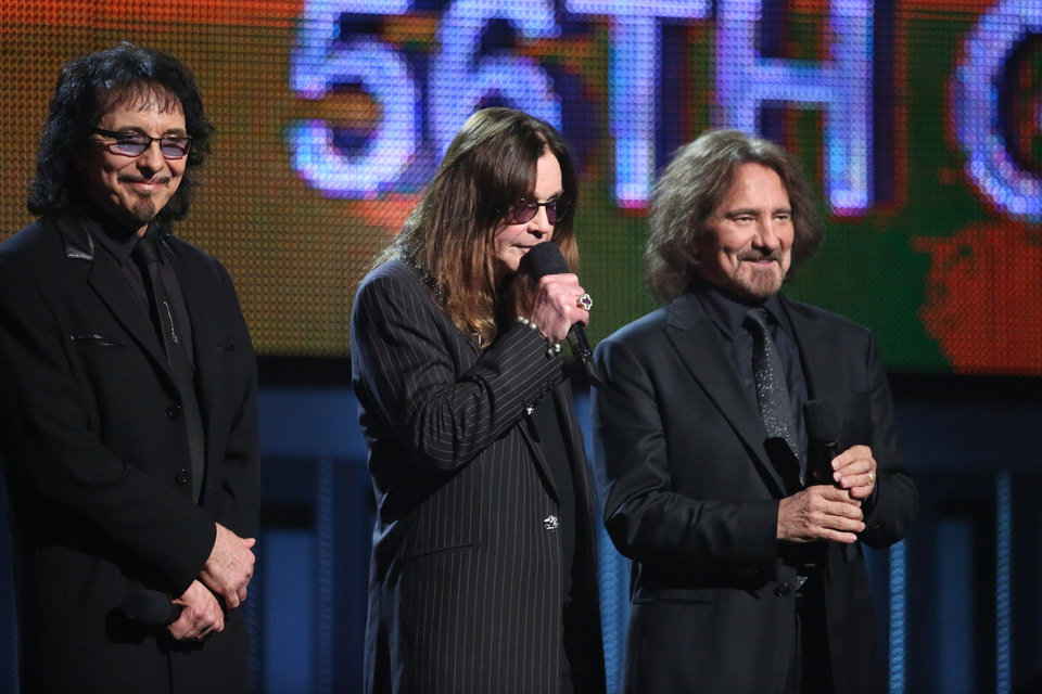 Photo - Tony Iommi, from left, Ozzy Osbourne and Geezer Butler speak on stage at the 56th annual Grammy Awards at Staples Center on Sunday, Jan. 26, 2014, in Los Angeles. (Photo by Matt Sayles/Invision/AP)