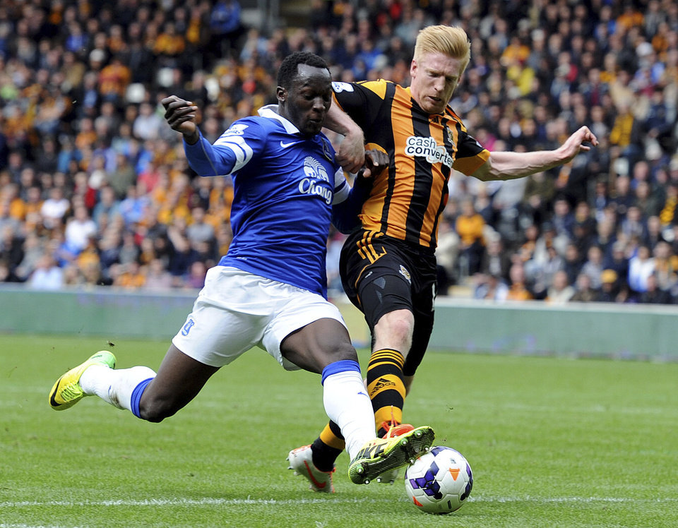 Photo - Everton player Romelu Lukaku, left, sees his shot blocked by Hull City's Paul McShane during their English Premier League soccer match at KC Stadium, Hull, England, Sunday May 11, 2014.  (AP Photo/Anna Gowthorpe, PA) UNITED KINGDOM OUT - NO SALES - NO ARCHIVES