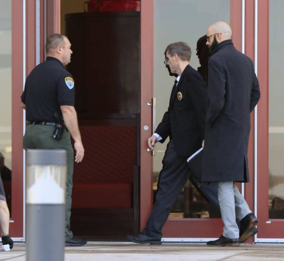 Photo - Tribal Police Chief James Collard enters the casino as police investigate a reported shooting at the Grand Casino in Shawnee, Okla. Tuesday, Jan. 10, 2017.  Photo by Paul Hellstern, The Oklahoman