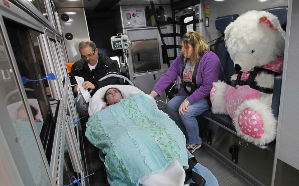 Brendine and her mother Christie King get a ride home from The Children's Center with EMSA paramedic Preston White, Thursday, December 23, 2010.  Brendine, 4, has been comatose since being under water in May and is home for the first time for Christmas. The teddy bear was give to Brendine by EMSA paramedics when she was transported home.  Photo by David McDaniel, The Oklahoman