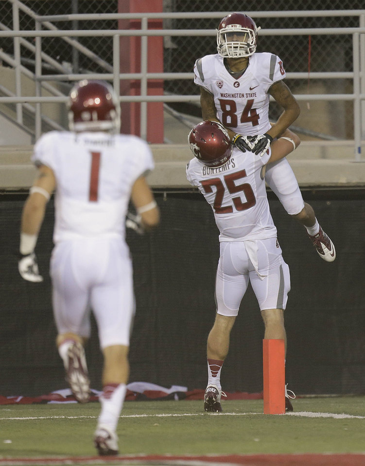 Photo -   Washington State wide receiver Gabe Marks (84) celebrates with wide receiver Bennett Bontemps (25) after scoring a touchdown in the second quarter against UNLV during an NCAA college football game, Friday, Sept. 14, 2012, in Las Vegas. (AP Photo/Julie Jacobson)