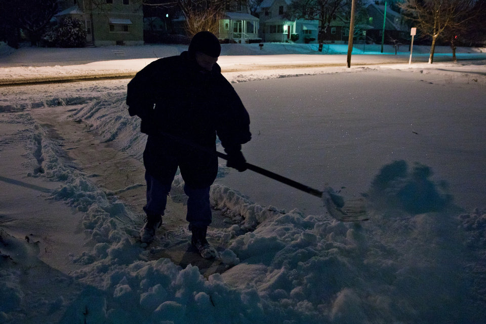 Photo - Matt Tabor shovels snow outside of his home on Chevrolet Avenue on Wednesday, Dec. 26, 2012 in Flint, Mich. Snow began falling around 3 p.m. in Genesee County and a winter weather advisory is in effect until 7am Thursday. Up to four inches of snowfall is expected in the area. (AP Photo/The Flint Journal, Griffin Moores) LOCAL TV OUT; LOCAL INTERNET OUT
