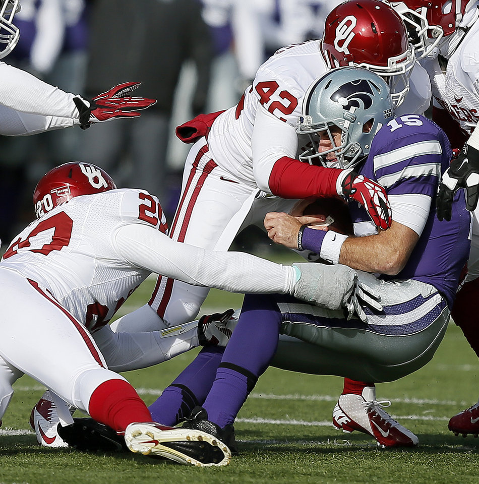 Oklahoma's Frank Shannon (20) and Oklahoma's Dominique Alexander (42) bring down Kansas State 's Jake Waters (15) during an NCAA college football game between the Oklahoma Sooners and the Kansas State University Wildcats at Bill Snyder Family Stadium in Manhattan, Kan., Saturday, Nov. 23, 2013. Oklahoma won 41-31. Photo by Bryan Terry, The Oklahoman