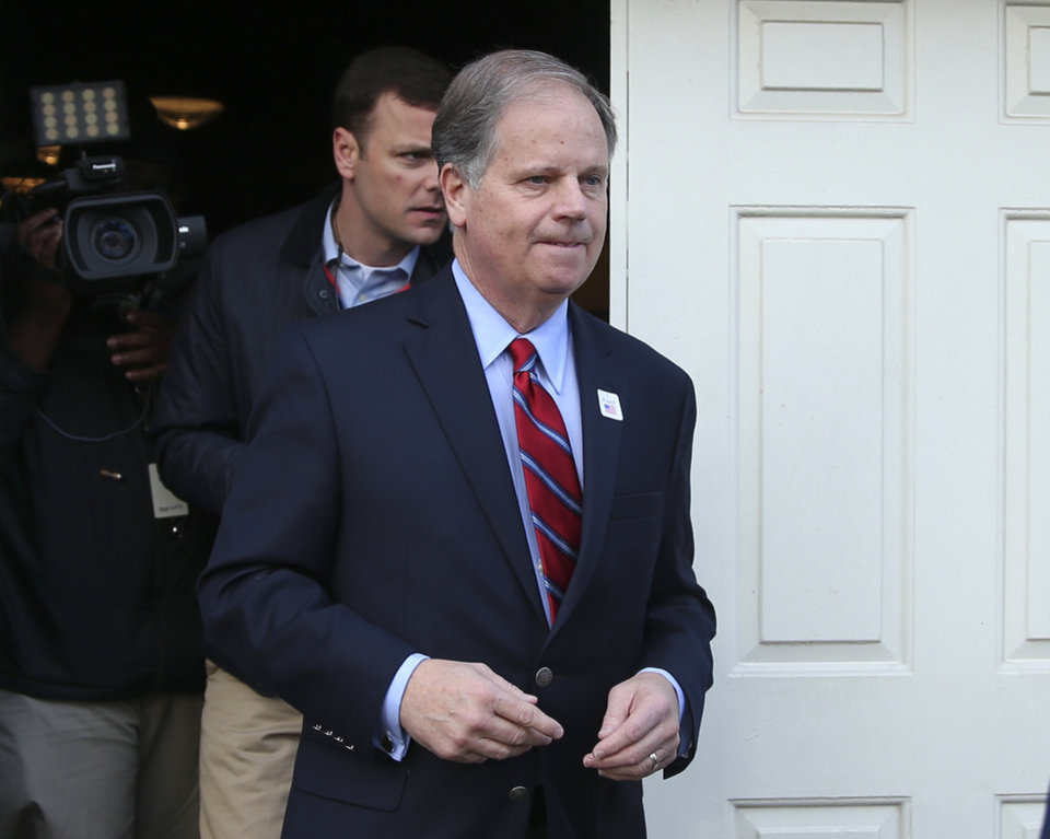 Photo - Democratic candidate for U.S. Senate Doug Jones leaves after casting his ballot Tuesday, Dec. 12, 2017, in Mountain Brook , Ala. Jones is facing Republican Roy Moore. (AP Photo/John Bazemore)