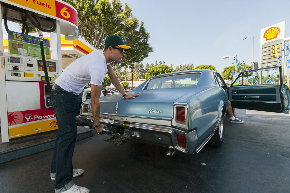 Motorist Tony Klein fills up his 1967 Cutlass V-8 at a gas station in Los Angeles Thursday, Oct. 4, 2012. Motorists in California paid an average of $4.232 per gallon Wednesday. That�s 45 cents higher than the national average and exceeded only by Hawaii among the 50 states. (AP Photo/Damian Dovarganes)