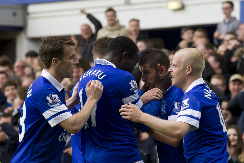 Photo - Everton's Kevin Mirallas, centre right, celebrates with teammates after scoring against Arsenal during their English Premier League soccer match at Goodison Park Stadium, Liverpool, England, Sunday April 6, 2014. (AP Photo/Jon Super)
