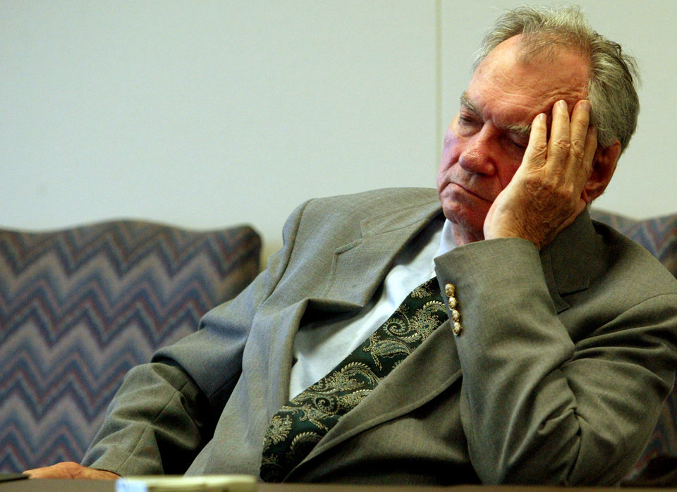 Photo - ** ADVANCE FOR USE SATURDAY, JAN. 1 - FILE ** Former Oklahoma state Sen.Gene Stipe listens to the proceeding during a hearing in which he is challenging a $65,000  cut in his retirement benefits, in this file photo shot in Oklahoma City, Friday, March 26, 2004. The sentencing of Stipe for his role in a 1998 federal campaign finance scandal was voted the number ten story in the state for 2004.  (AP Photo/Sue Ogrocki)