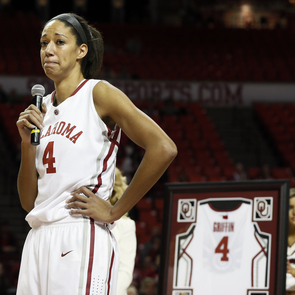 Photo - OU senior Nicole Griffin (4) speaks after being honored during senior night after a women's college basketball game between the Oklahoma Sooners and Texas Tech at Lloyd Noble Center in Norman, Okla., Monday, March 3, 2014. OU won 87-32. Photo by Nate Billings, The Oklahoman