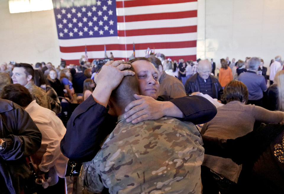 John Farrow hugs his son Justin to welcome him home during the return ceremony for more than 200 National Guard 45th Infantry Brigade Combat Team troops at the National Guard Base on Monday, March 12, 2012, in Oklahoma City, Oklahoma.  Photo by Chris Landsberger, The Oklahoman