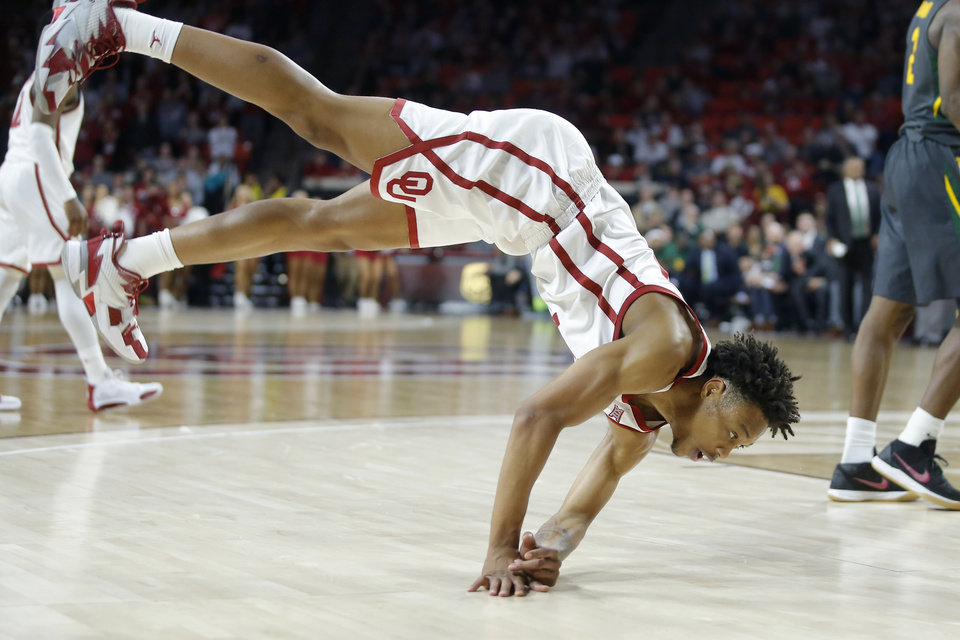 Photo - Oklahoma's Alondes Williams (15) gets up after getting fouled during a men's NCAA basketball game between the University of Oklahoma Sooners (OU) and the Baylor Bears at the Lloyd Noble Center in Norman, Okla., Tuesday, Feb. 18, 2020. Baylor won 65-54. [Bryan Terry/The Oklahoman]