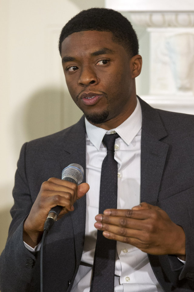 Photo - Actor Chadwick Boseman, who plays baseball great Jackie Robinson in the movie