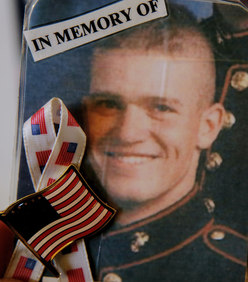 Photo - Lance Cpl. Thomas A. Blair is shown in this photo at his father's home in Gravette, Ark.  Jim Beckel