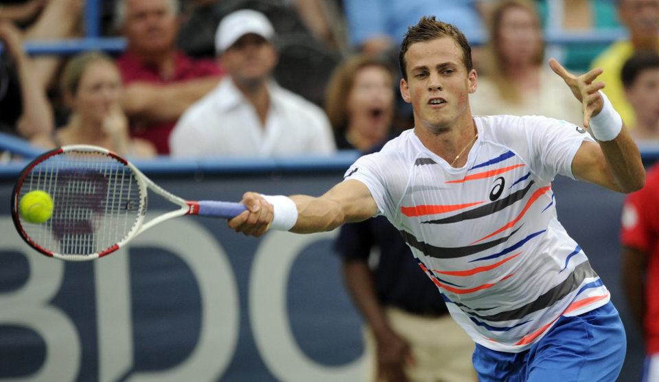 Photo - Vasek Pospisil, of Canada, reaches for the ball against Richard Gasquet, of France, during a match at the Citi Open tennis tournament, Saturday, Aug. 2, 2014, in Washington. (AP Photo/Nick Wass)