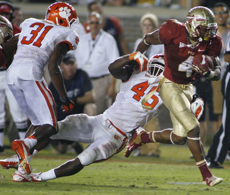 Photo -   Florida State running back Chris Thompson (4) sheds Clemson linebacker Jonathan Willard (46) during the third quarter of an NCAA college football game on Saturday, Sept. 22, 2012, in Tallahassee, Fla. Florida State won 49-37. (AP Photo/Phil Sears)