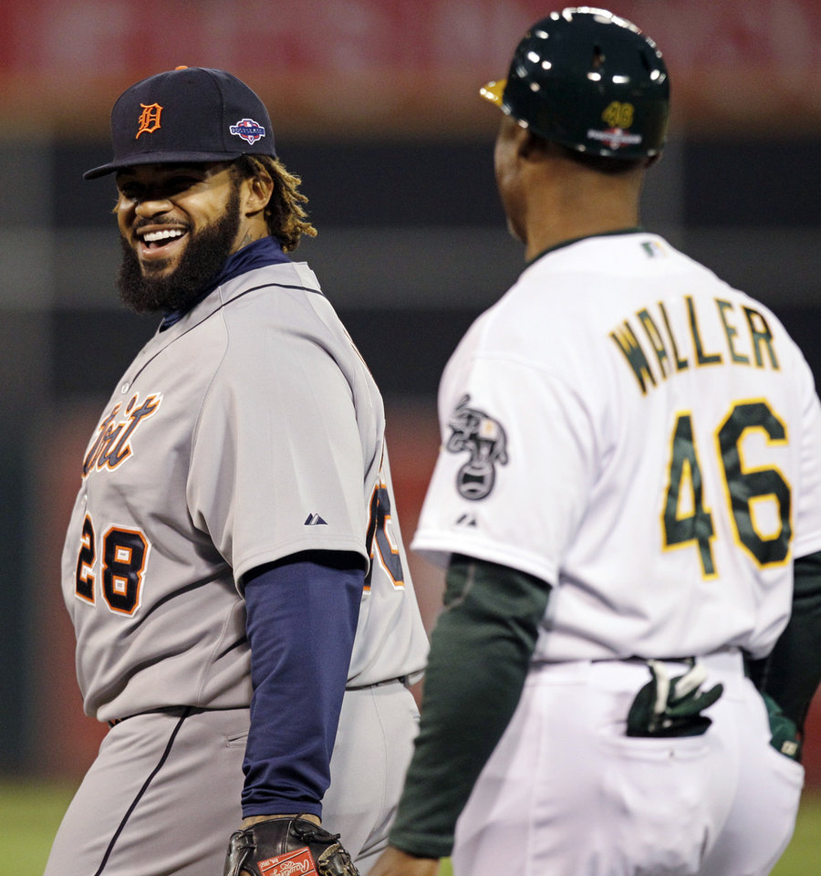 Photo -   Detroit Tigers first baseman Prince Fielder, left, smiles at Oakland Athletics first base coach Tye Waller in the first inning of Game 4 of their American League division baseball series in Oakland, Calif., Wednesday, Oct. 10, 2012. (AP Photo/Ben Margot)