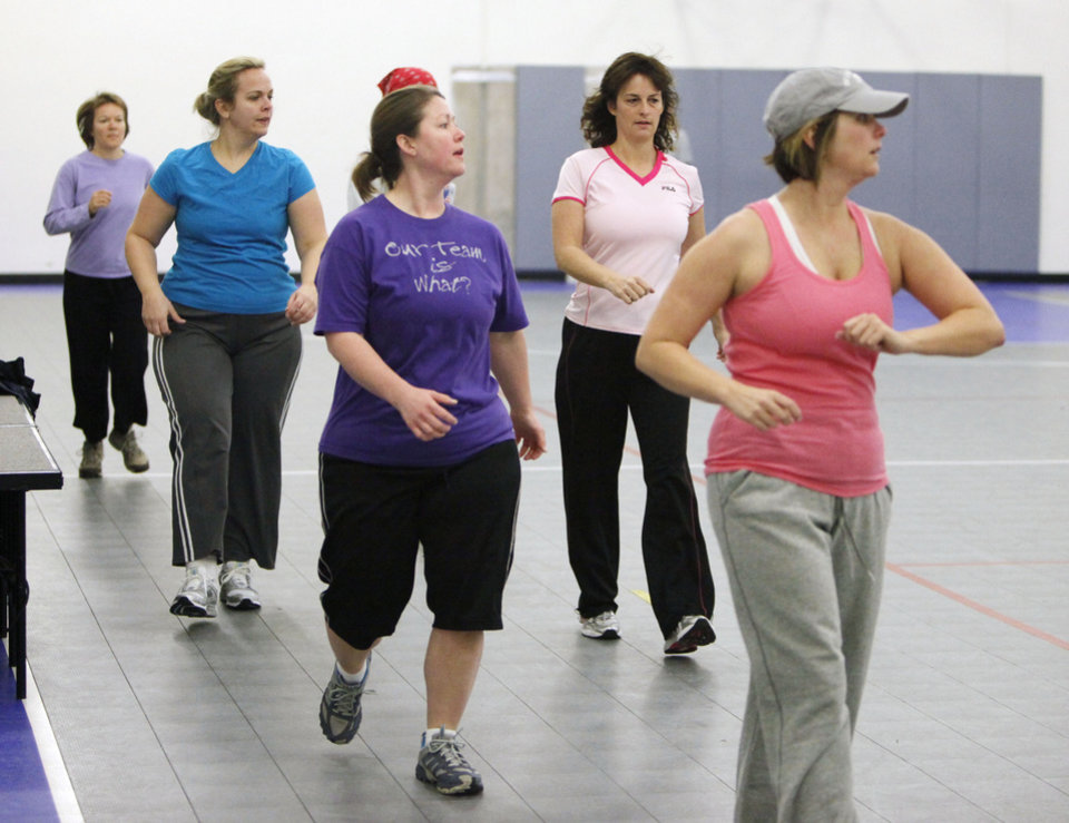 Photo - EXERCISE: Ladies walk laps around the gym during a New Year's Boot Camp at the Holy Trinity Lutheran Church in Edmond, OK, Saturday, Jan. 2, 2010. By Paul Hellstern, The Oklahoman ORG XMIT: KOD
