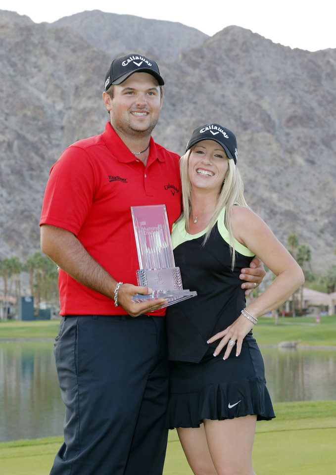 Photo - Patrick Reed, left, and wife Justine Reed pose with the trophy after the final round of the Humana Challenge PGA golf tournament on the Palmer Private course at PGA West, Sunday, Jan. 19, 2014, in La Quinta, Calif. (AP Photo/Matt York)