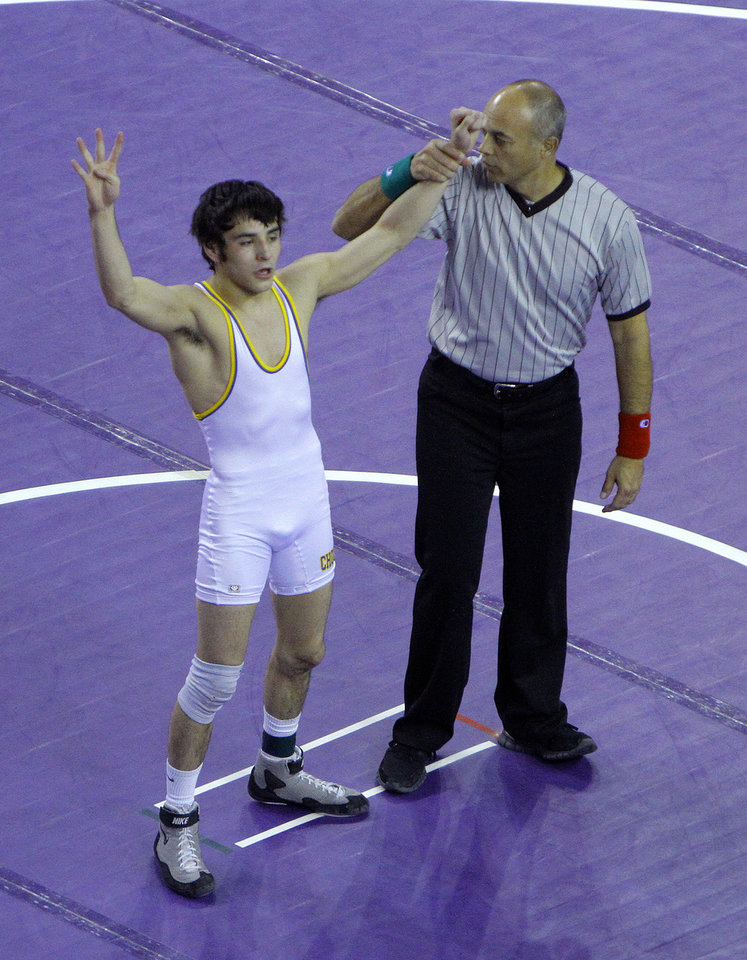 Photo - Choctaw's Kyle Garcia celebrates his win over Union's Luke Wolfenberger in the in 126-pound match during the state wrestling championships at the State Fair Arena in Oklahoma City, Saturday, Feb. 25, 2012. Photo by Sarah Phipps, The Oklahoman