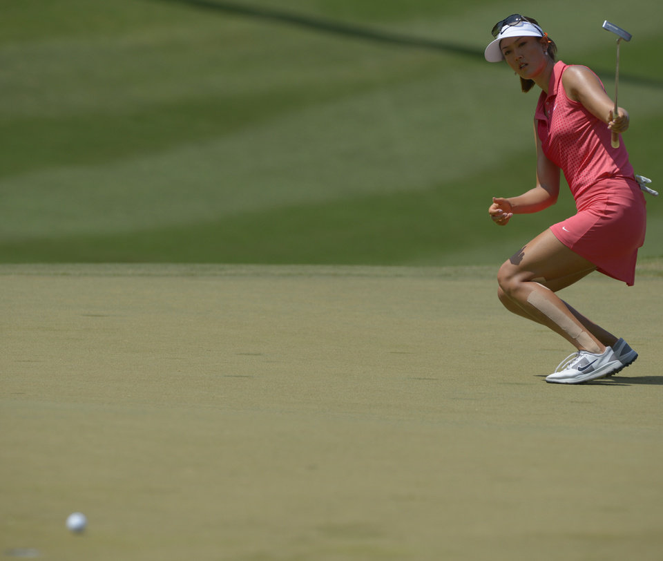 Photo - Michelle Wie tries to steer her putt on the tenth hole in the final round of the Airbus LPGA Classic golf tournament at Magnolia Grove on Sunday, May 25, 2014, in Mobile, Ala. (AP Photo/G.M. Andrews)