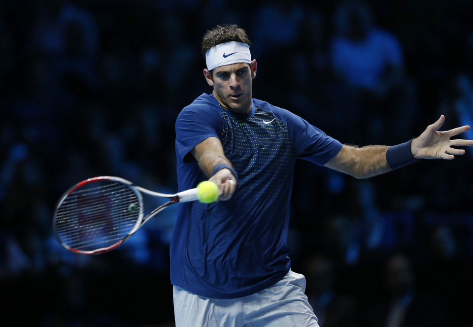 Photo - Juan Martin Del Potro of Argentina plays a return to Novak Djokovic of Serbia during their ATP World Tour Finals single tennis match at the O2 Arena in London Thursday, Nov. 7, 2013. (AP Photo/Sang Tan)